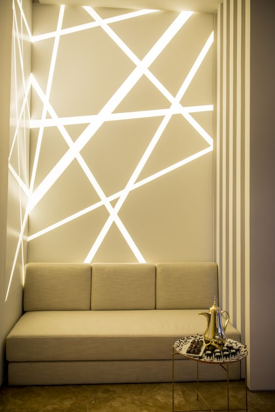 LED lights installed into the corner of a sitting area in a geometric design.